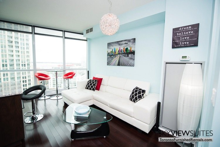 furnished suites toronto Neptune living room with red barstools