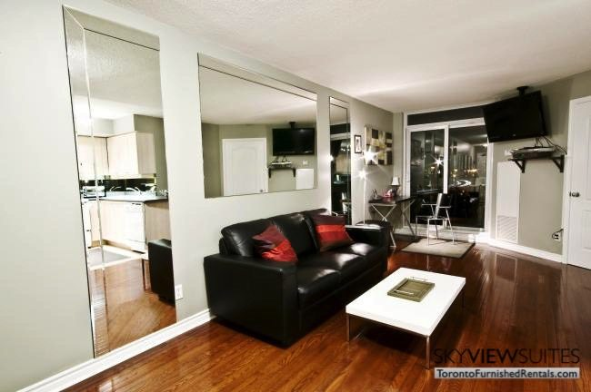 North York executive rentals Toronto living room with black couch