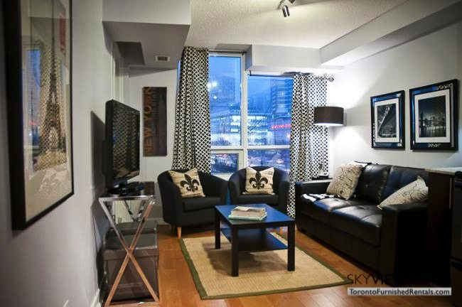 furnished suites toronto harbourfront living room with fleur-de -is pillows