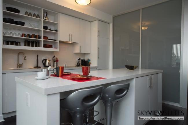 furnished apartments toronto portland kitchen and island table