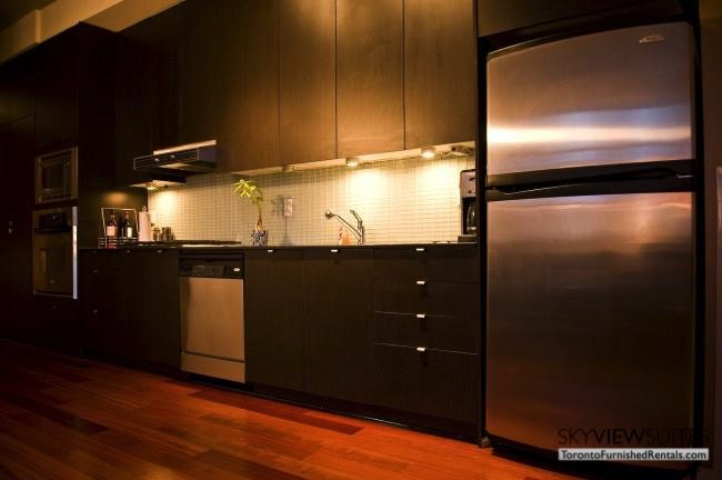 furnished suites toronto 23 Brant Street kitchen counter and fridge
