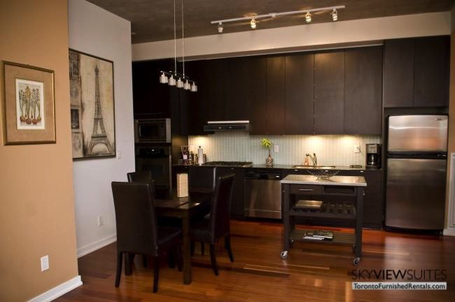 furnished suites toronto 23 Brant Street dining room and kitchen