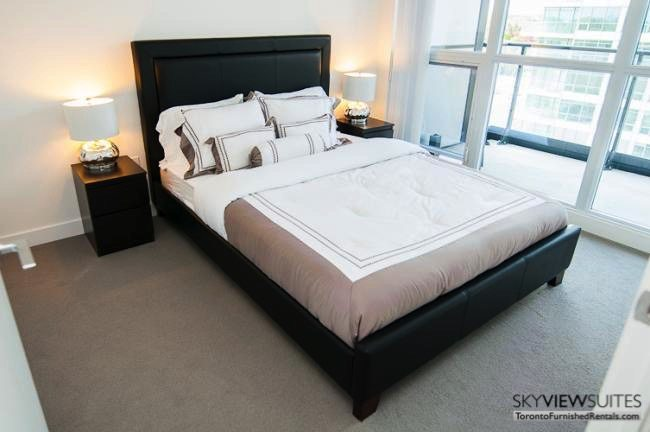 Leslie and Sheppard executive rentals toronto bedroom with nightstand lamps