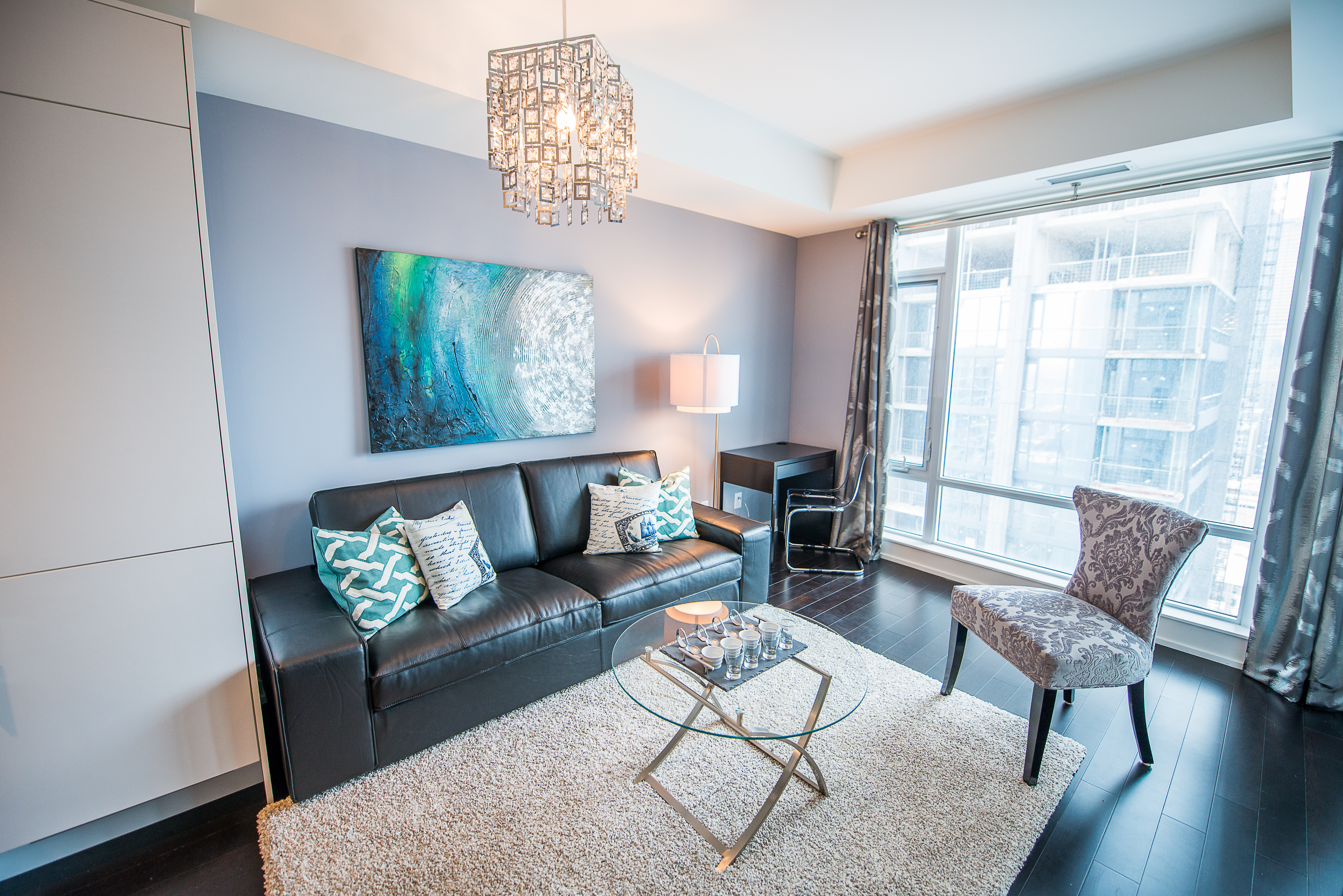 corporate rentals toronto king and john living room with couch and coffee table