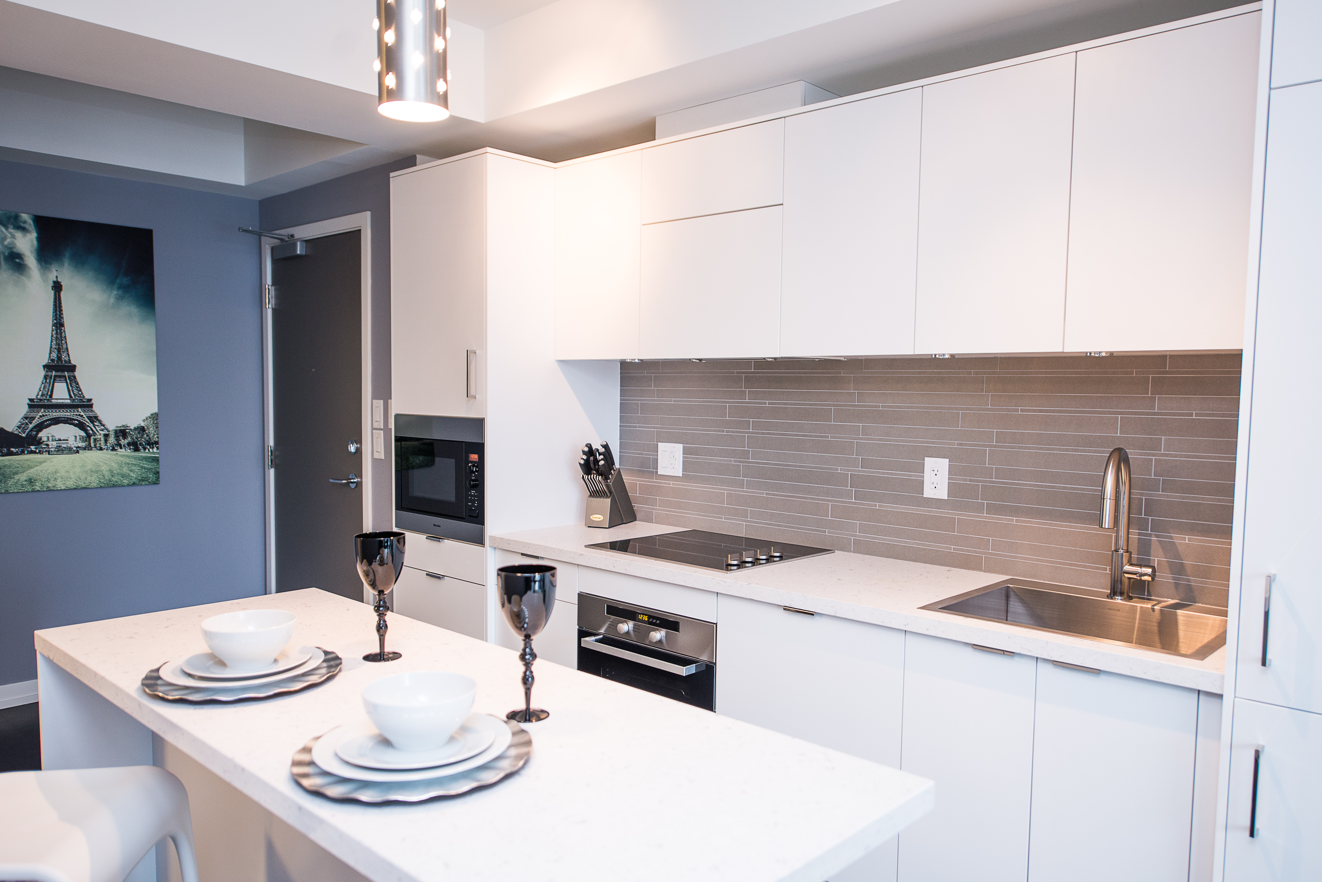 corporate rentals toronto king and john kitchen with island