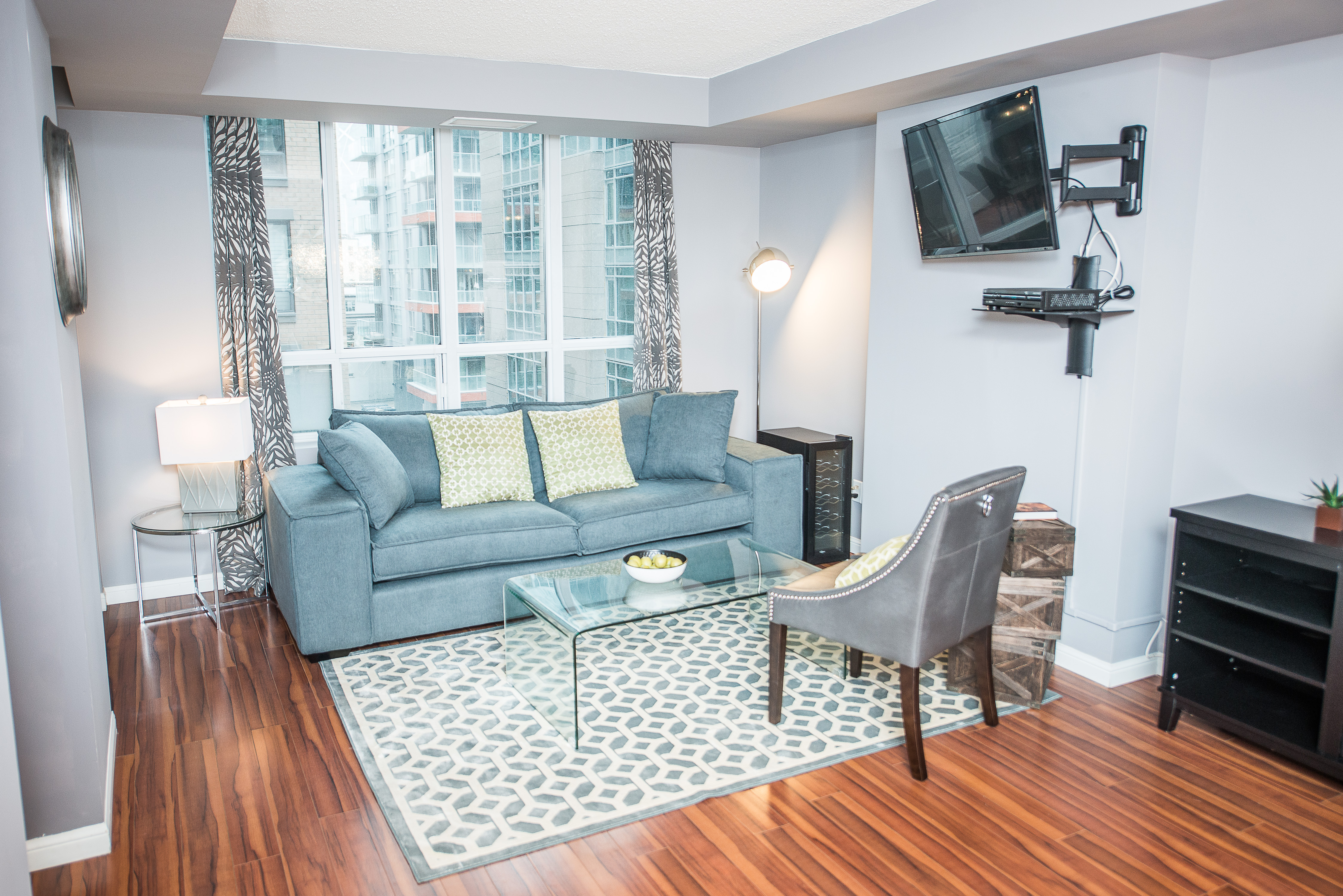 serviced apartments toronto financial district living room with wall-mounted television