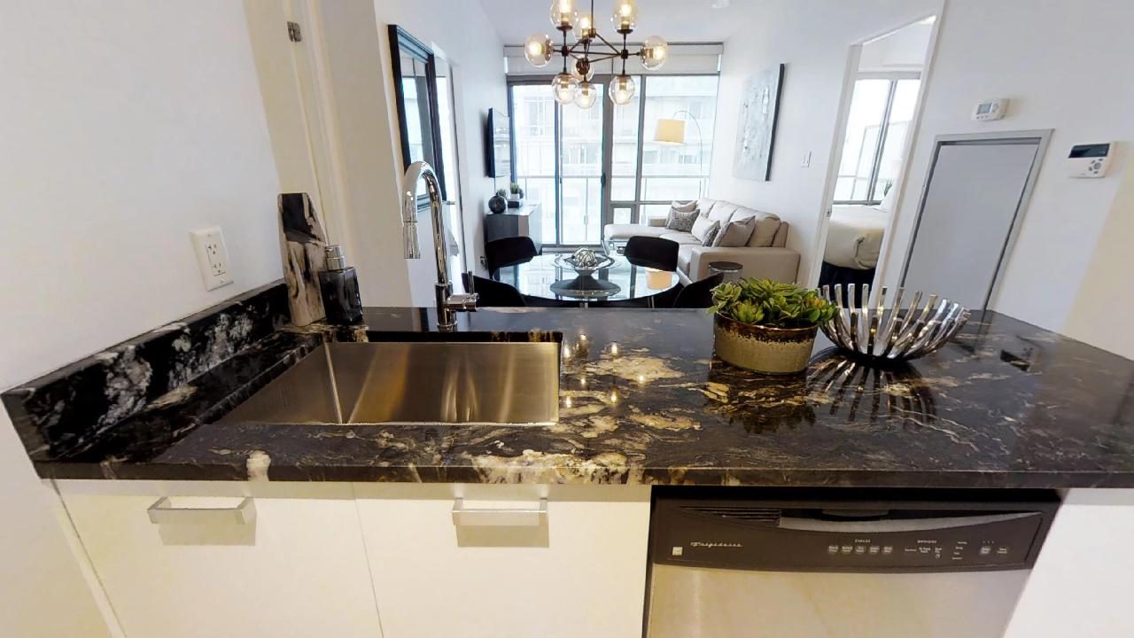 The kitchen counter in a Murano furnished condominium in toronto