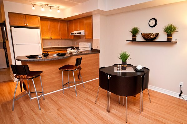 corporate rentals toronto empire living room and kitchen