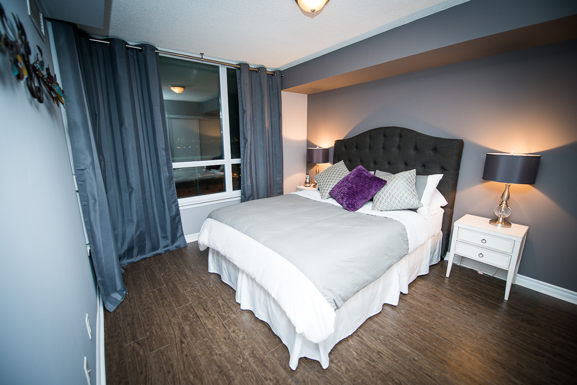 short term rentals toronto the empire bedroom with purple pillow