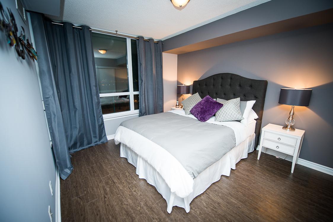short term rentals toronto the empire bedroom with purple pillow