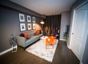 short term rentals toronto the empire living room with television and couch