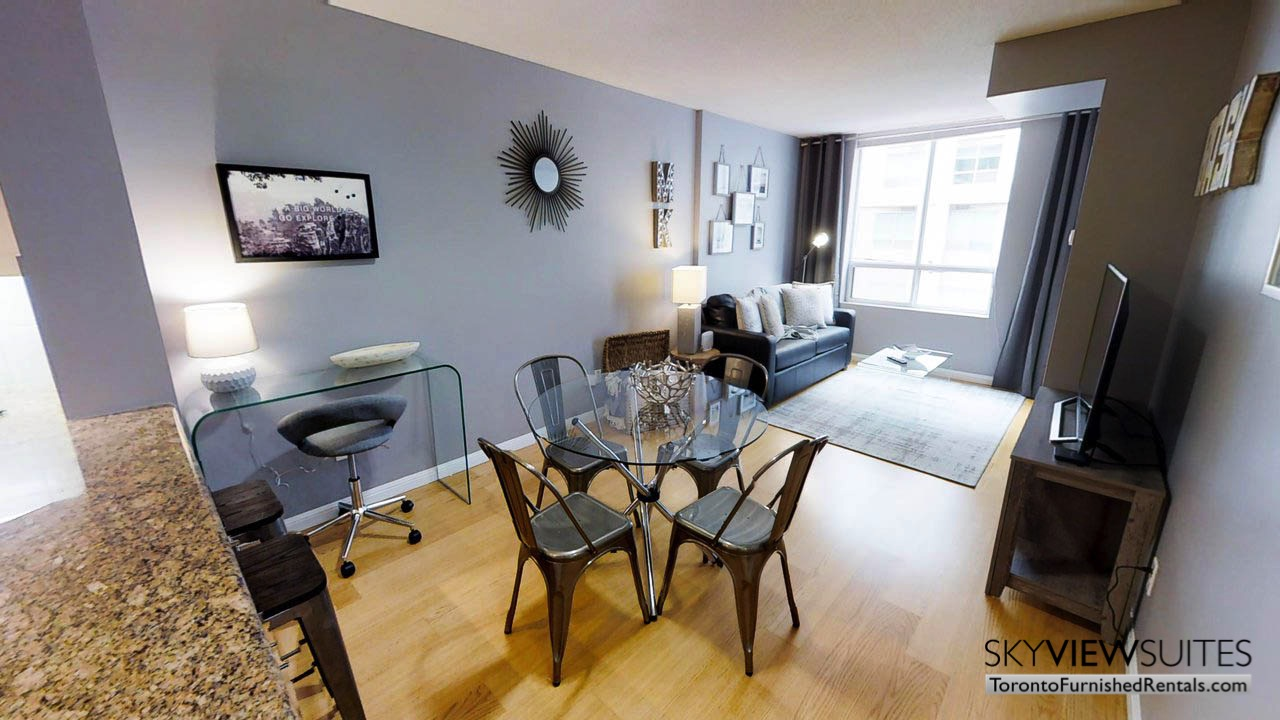 furnished suites toronto university plaza living room with table
