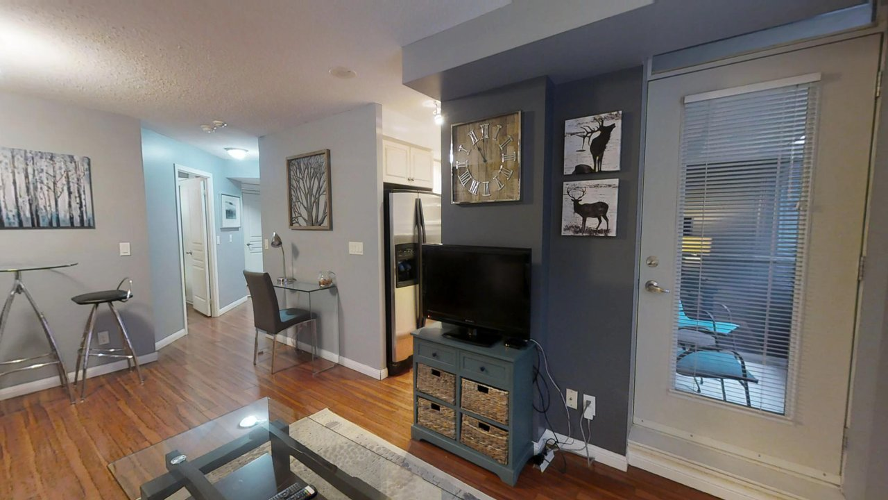 furnished apartments toronto university plaza living room with door to balcony