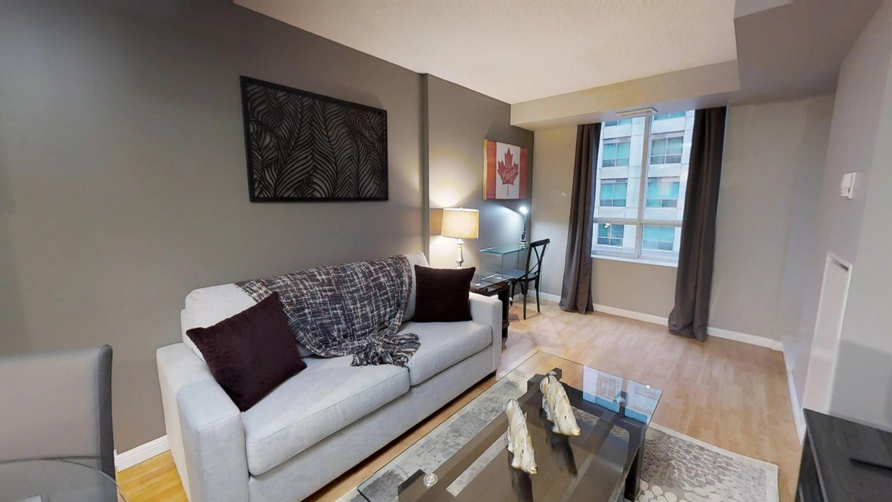 furnished suites toronto university plaza living room featuring couch