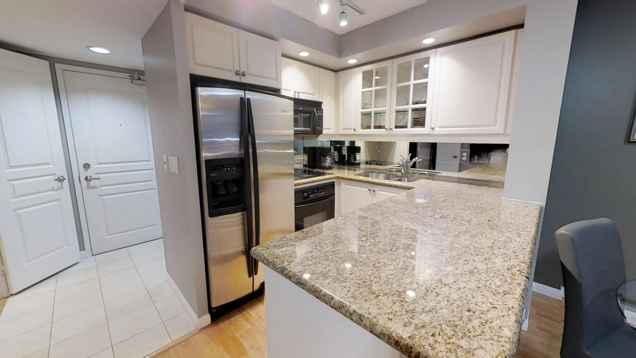 furnished suites toronto university plaza kitchen with fridge