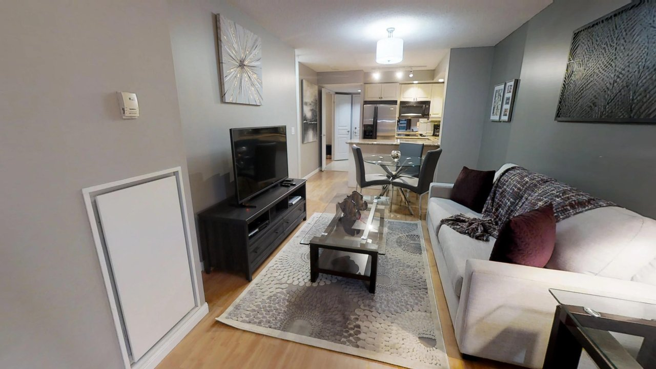 furnished suites toronto university plaza television and couch open concept condo