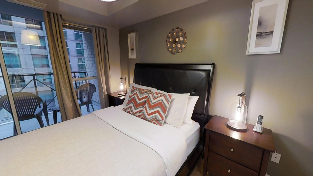 furnished suites toronto university plaza bedroom with patio
