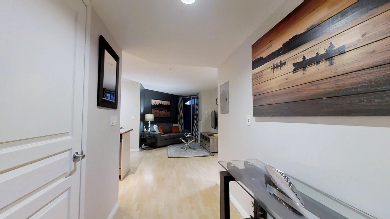 furnished apartments toronto university plaza foyer with art and view of living room