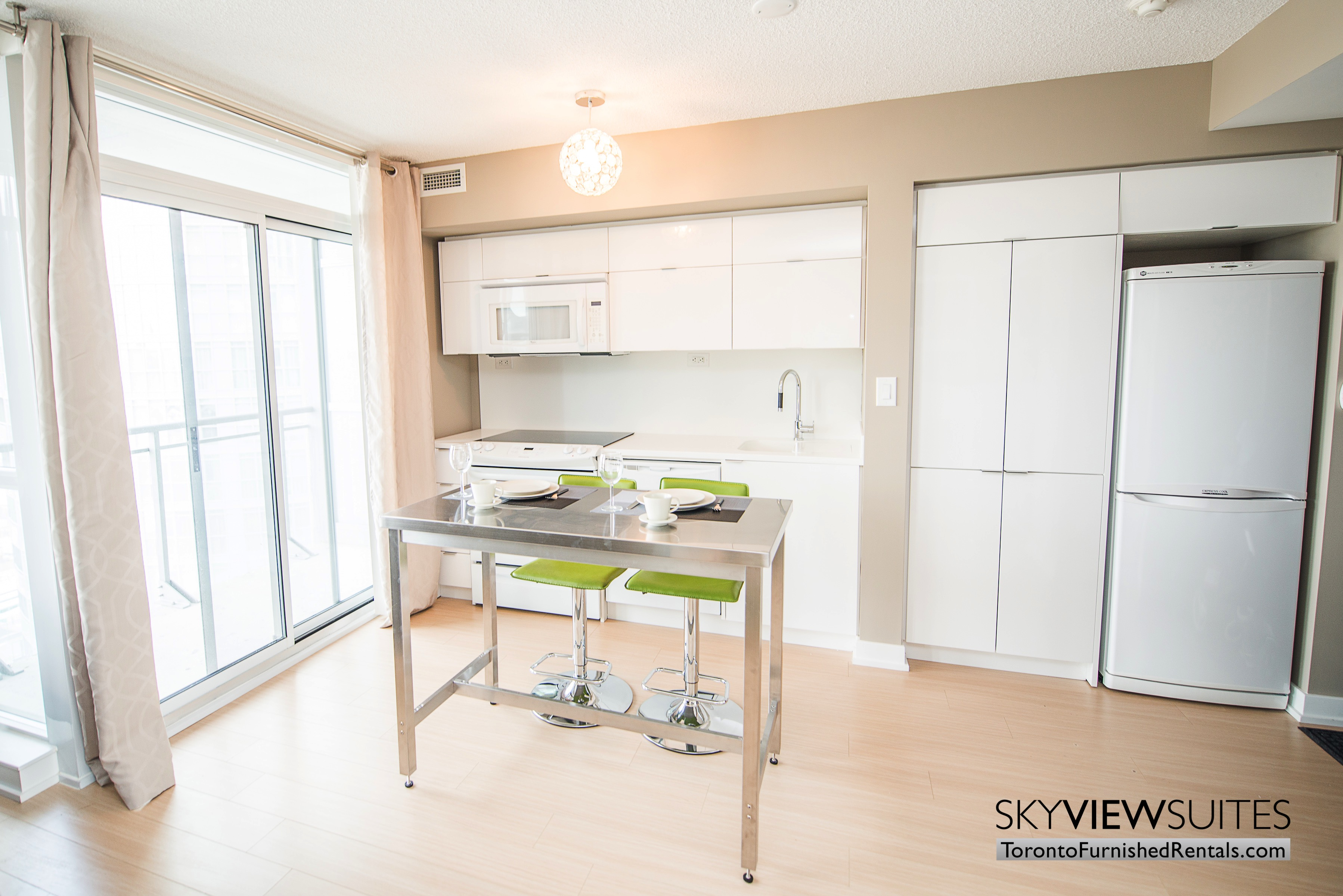 furnished apartments toronto parade kitchen and dining table