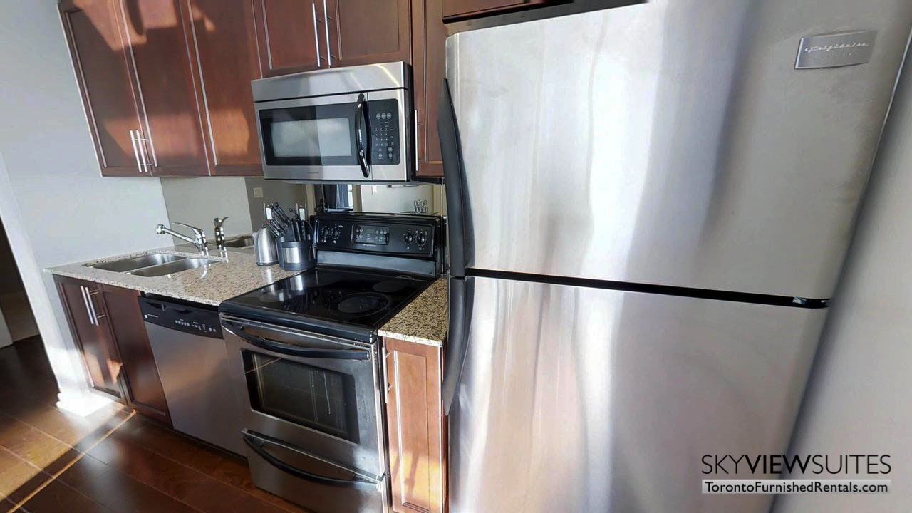 furnished rentals toronto Maple Leaf Square kitchen fridge, oven, and microwave
