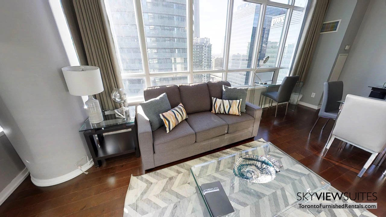 furnished rentals toronto Maple Leaf Square living room featuring couch, coffee table and view of the city