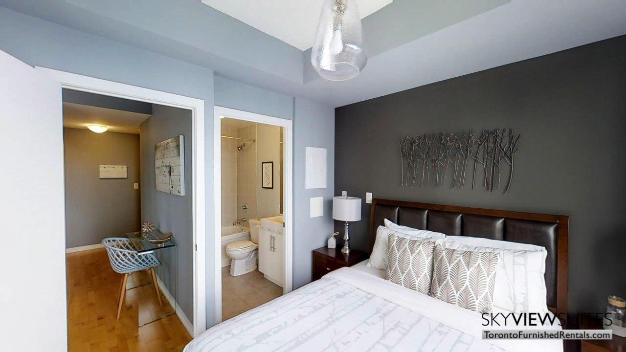 short term rentals Toronto Maple Leaf Square bedroom featuring en suite bathroom