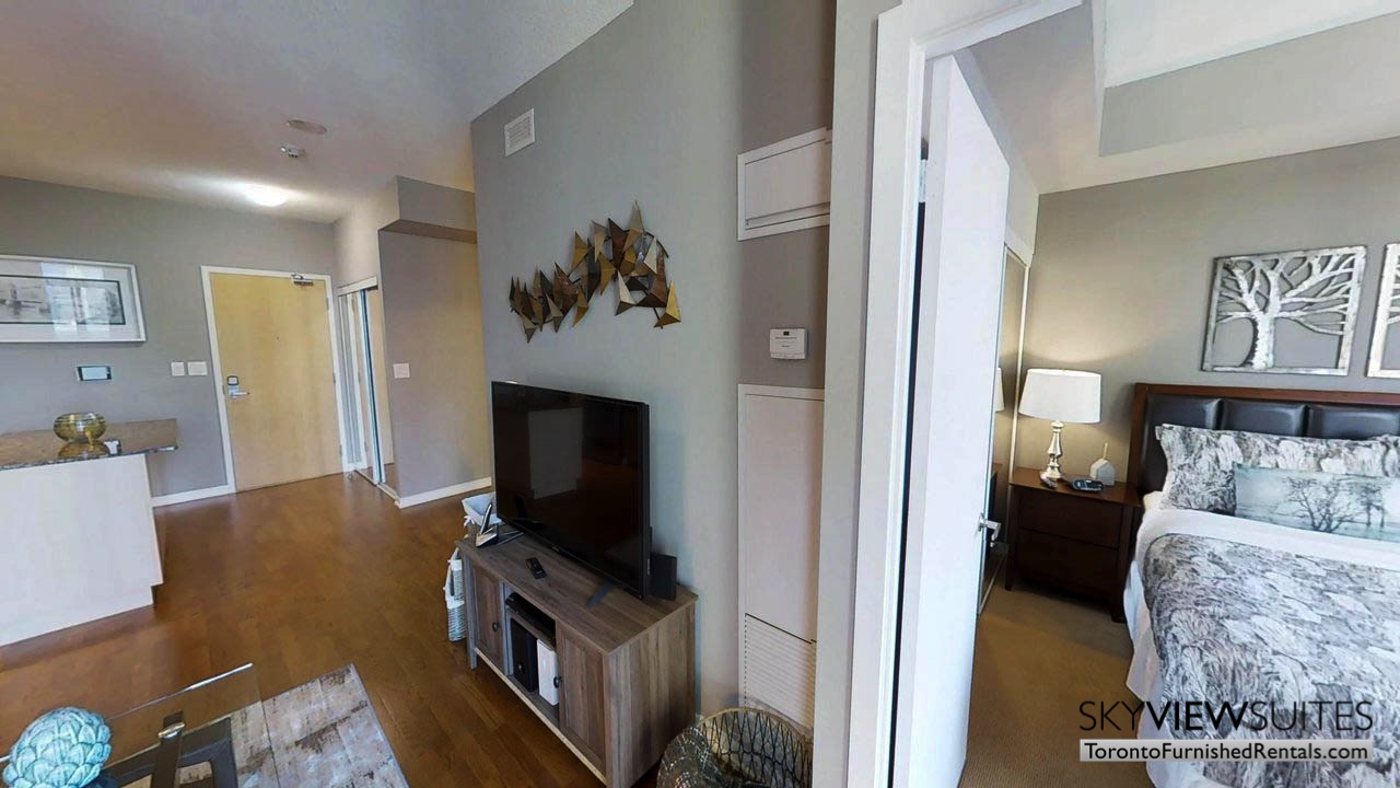 furnished apartments toronto Maple Leaf Square living room with tv