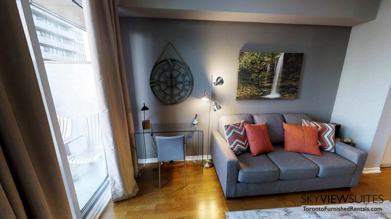 furnished apartments toronto Maple Leaf Square living room couch and window