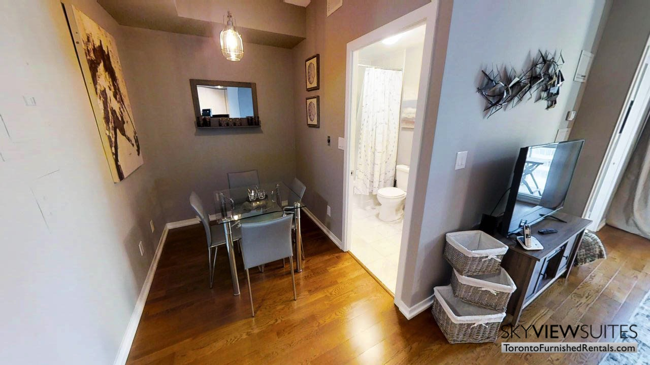 furnished apartments toronto Maple Leaf Square dining room and bathroom