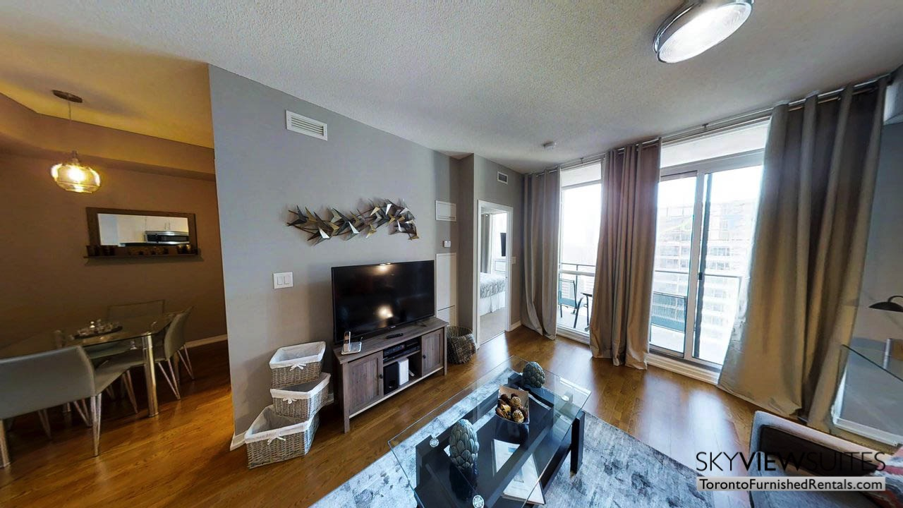 furnished apartments toronto Maple Leaf Square living room with coffee table tv and view of the city