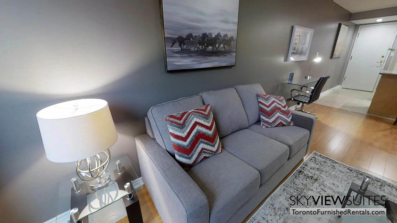 furnished rentals toronto simcoe and richmond couch in living room