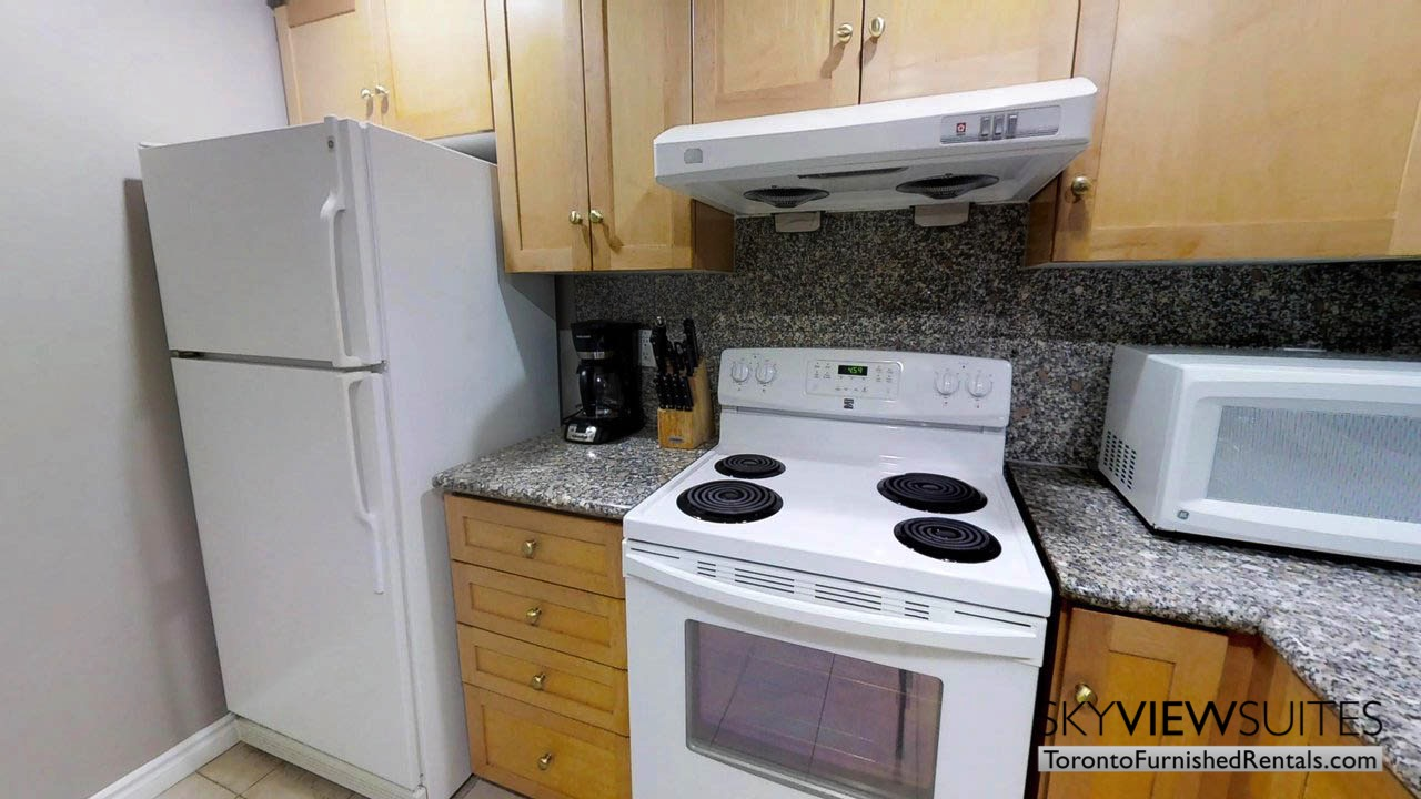 furnished rentals toronto simcoe and richmond kitchen with fridge and stove