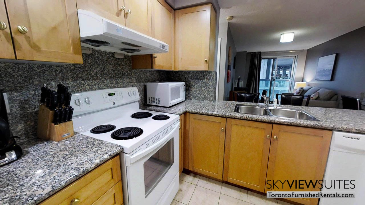 furnished rentals toronto simcoe and richmond kitchen and living room