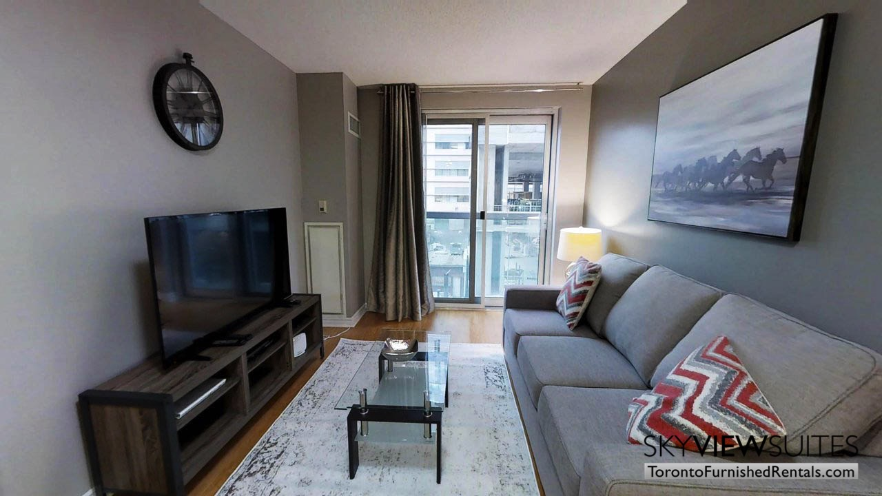 furnished rentals toronto simcoe and richmond living room television