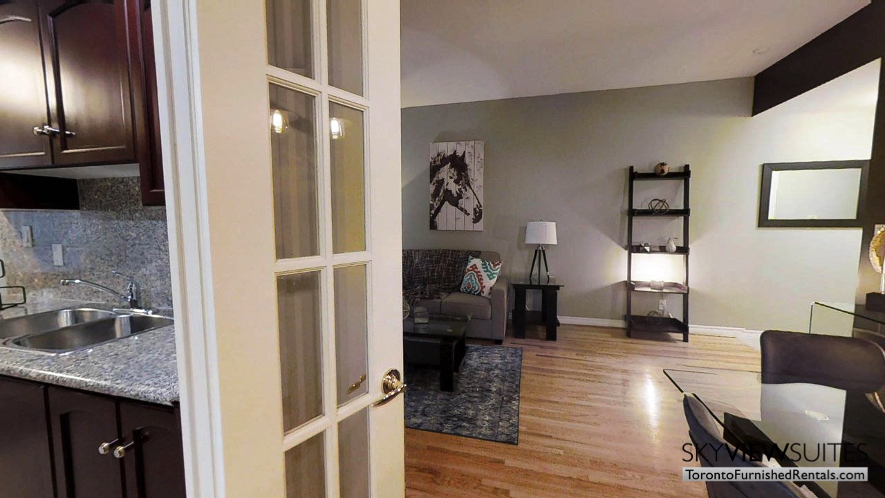 short term rentals toronto qwest couch and table in living room with horse art