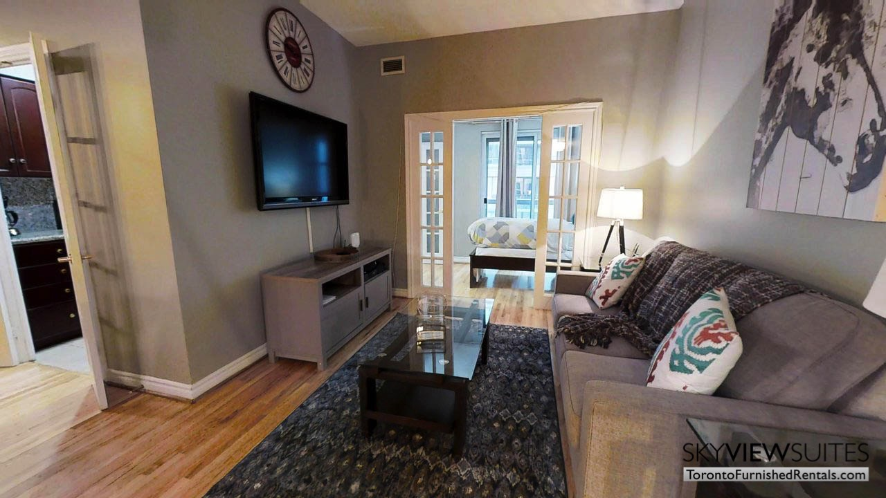 short term rentals toronto qwest couch in living room and television