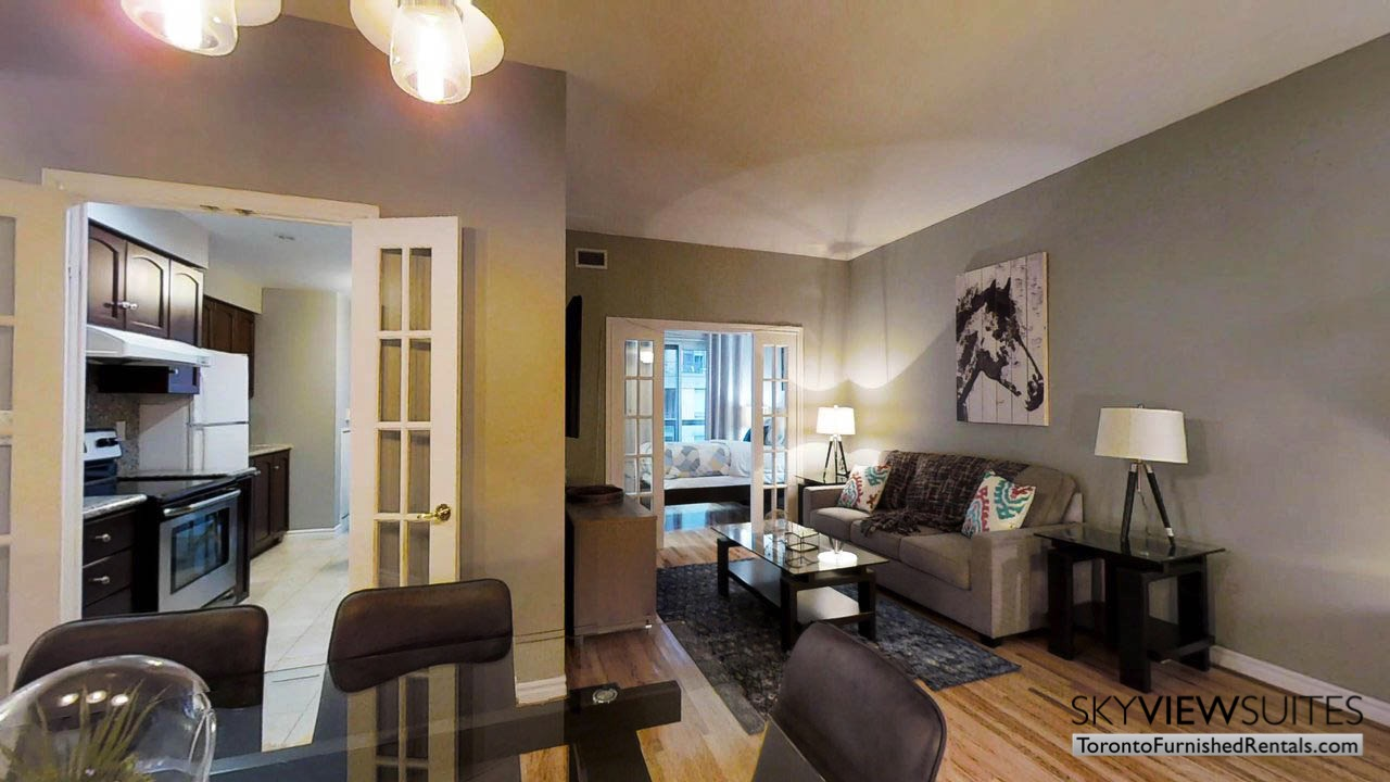 short term rentals toronto qwest view of living room, kitchen and bedroom