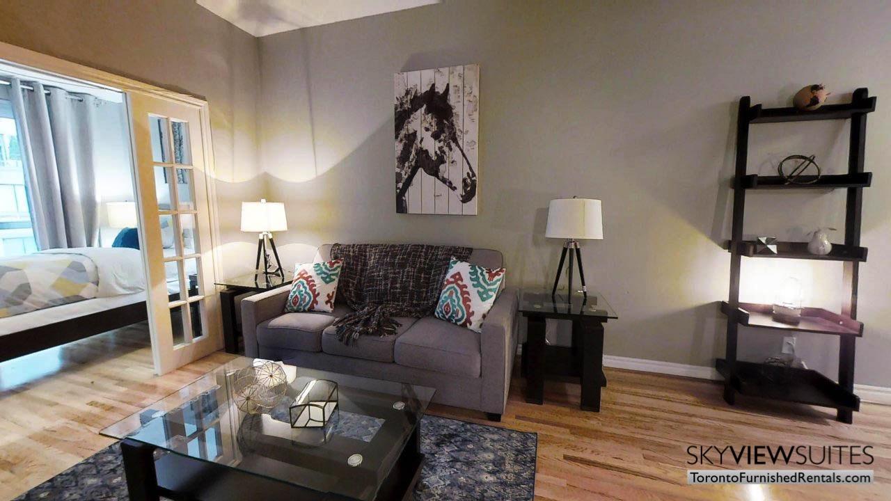 short term rentals toronto qwest living room with door to bedroom