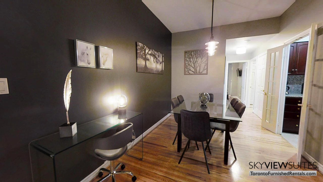 short term rentals toronto qwest living room and chair with desk