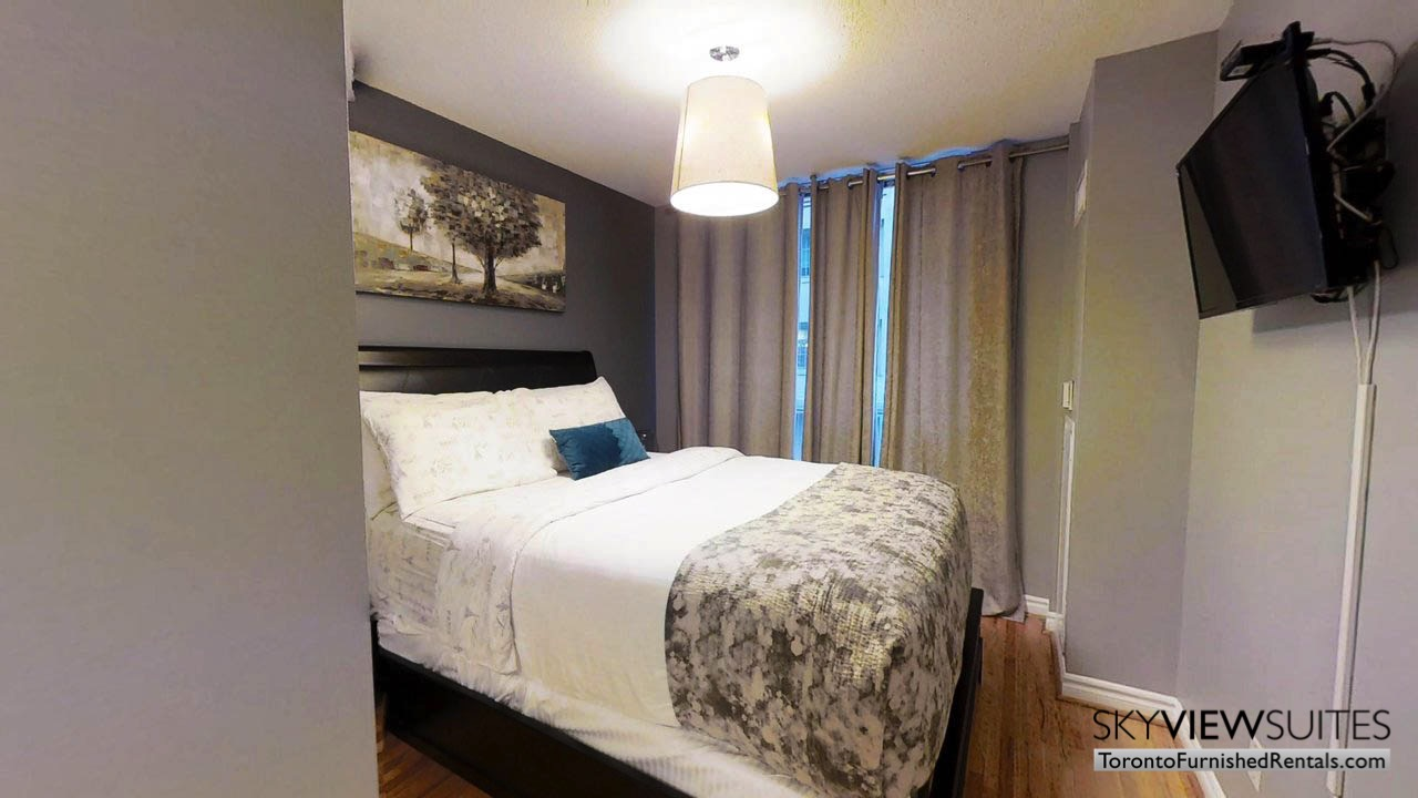 short term rentals toronto qwest bedroom with television wall mount