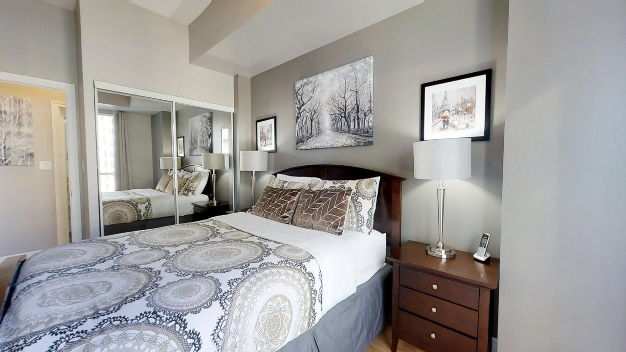 furnished apartments toronto QWEST bedroom with mirror and landline