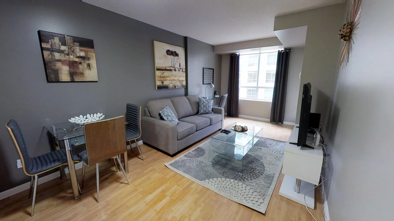 executive rentals toronto university plaza living room and dining table