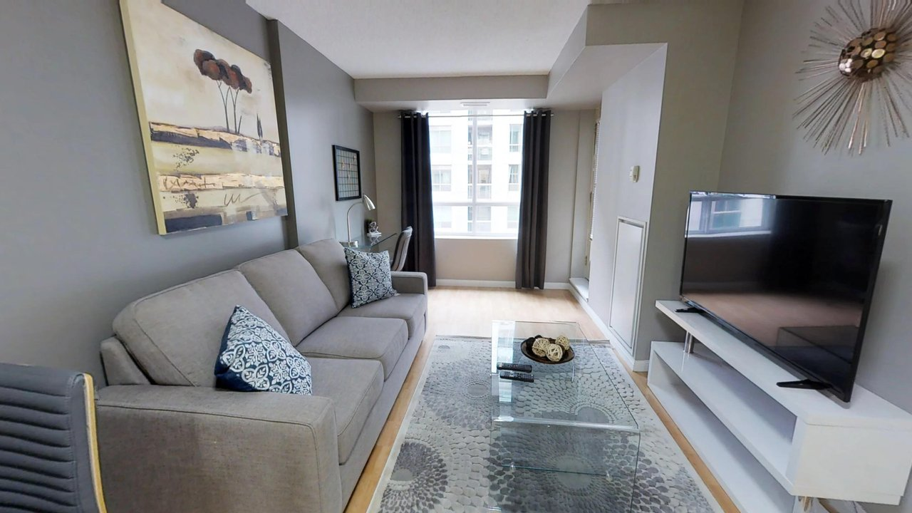 executive rentals toronto university plaza living room with couch tv and window