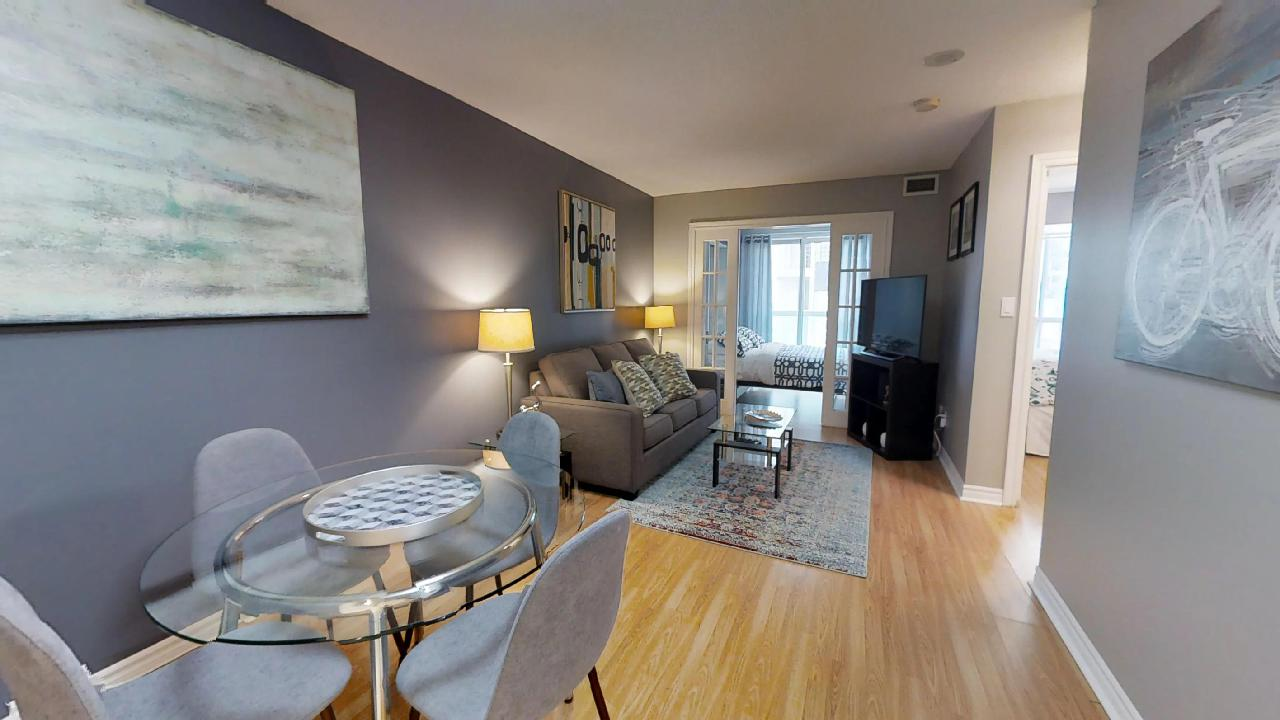 toronto furnished apartment living room and dining table