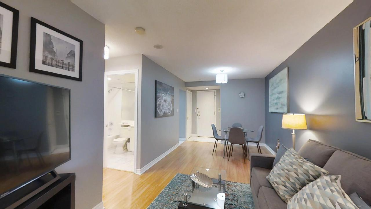 toronto furnished apartment living room and dining table near queen and university