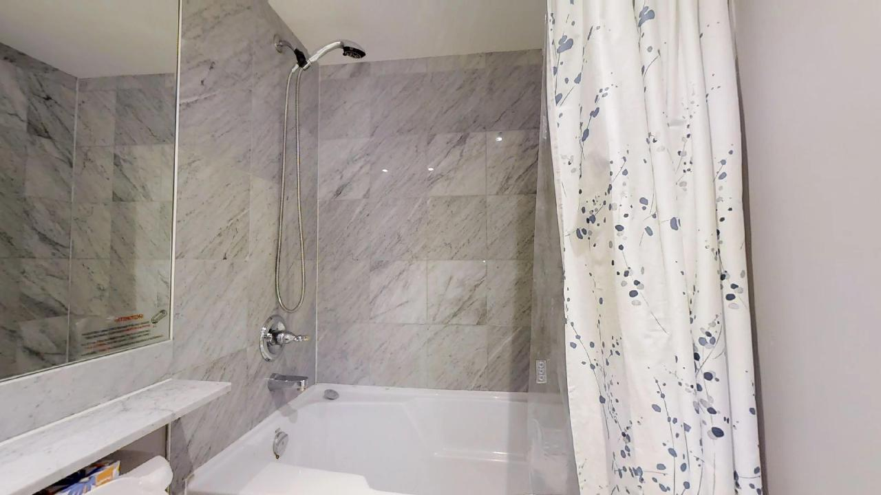 University plaza toronto furnished apartment shower and tub
