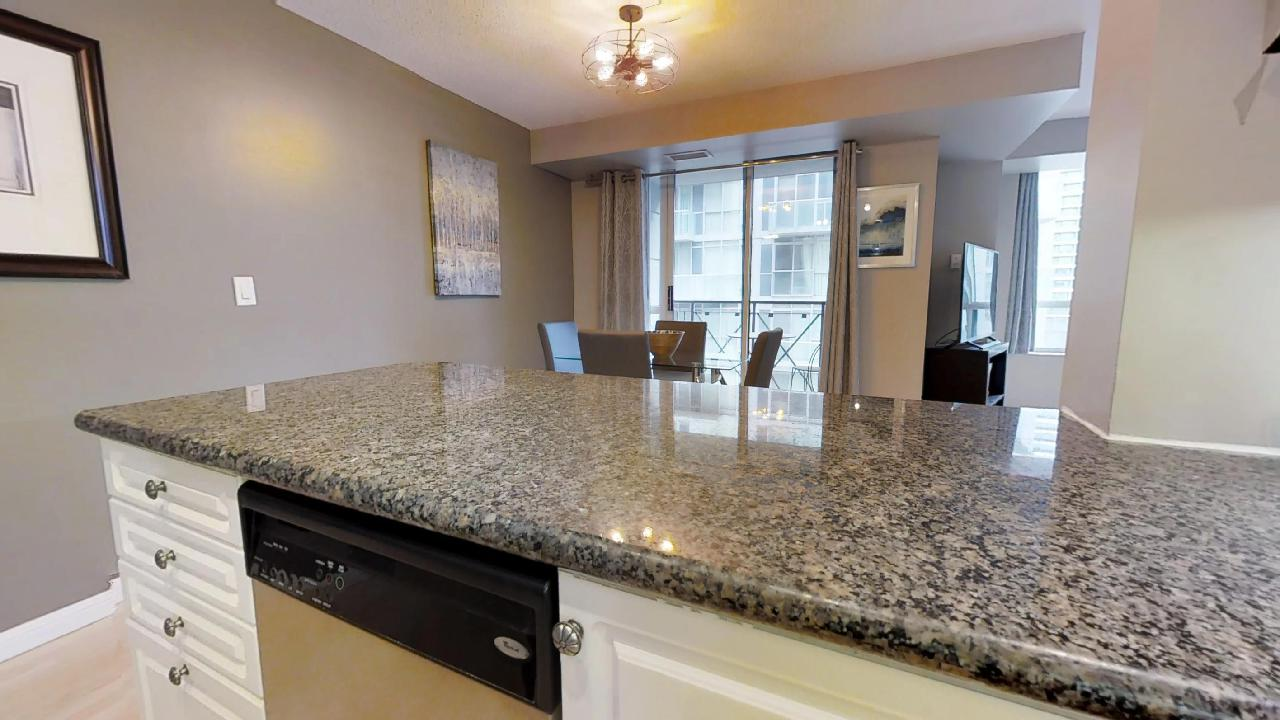 kitchen counter and dining area in a furnished apartment near the entertainment district