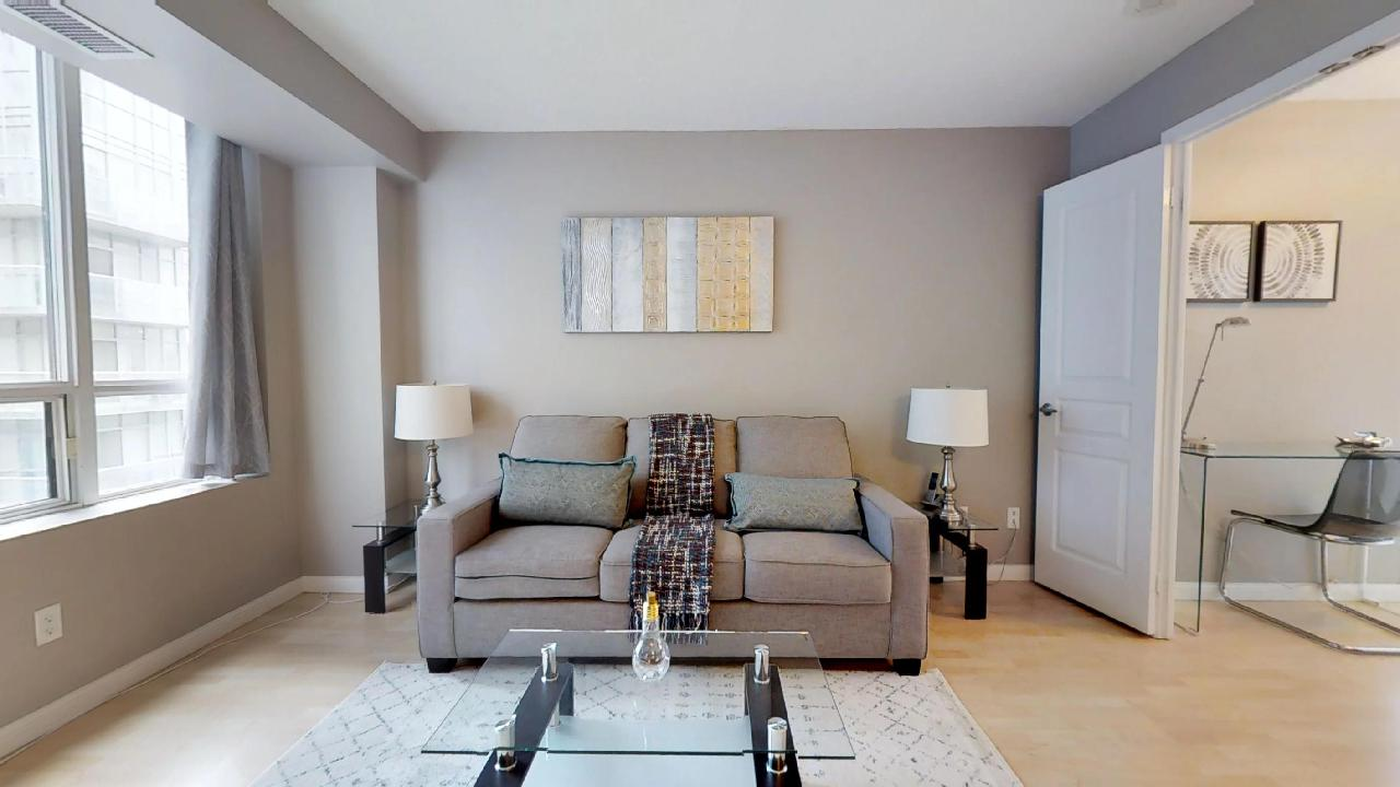 pullout couch in a two bedroom toronto furnished apartment, near the CN tower