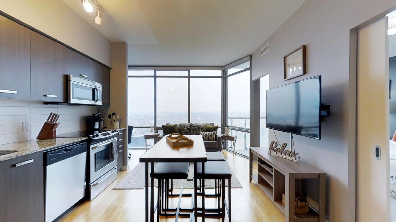 Toronto furnished apartment near bay and college living room and kitchen
