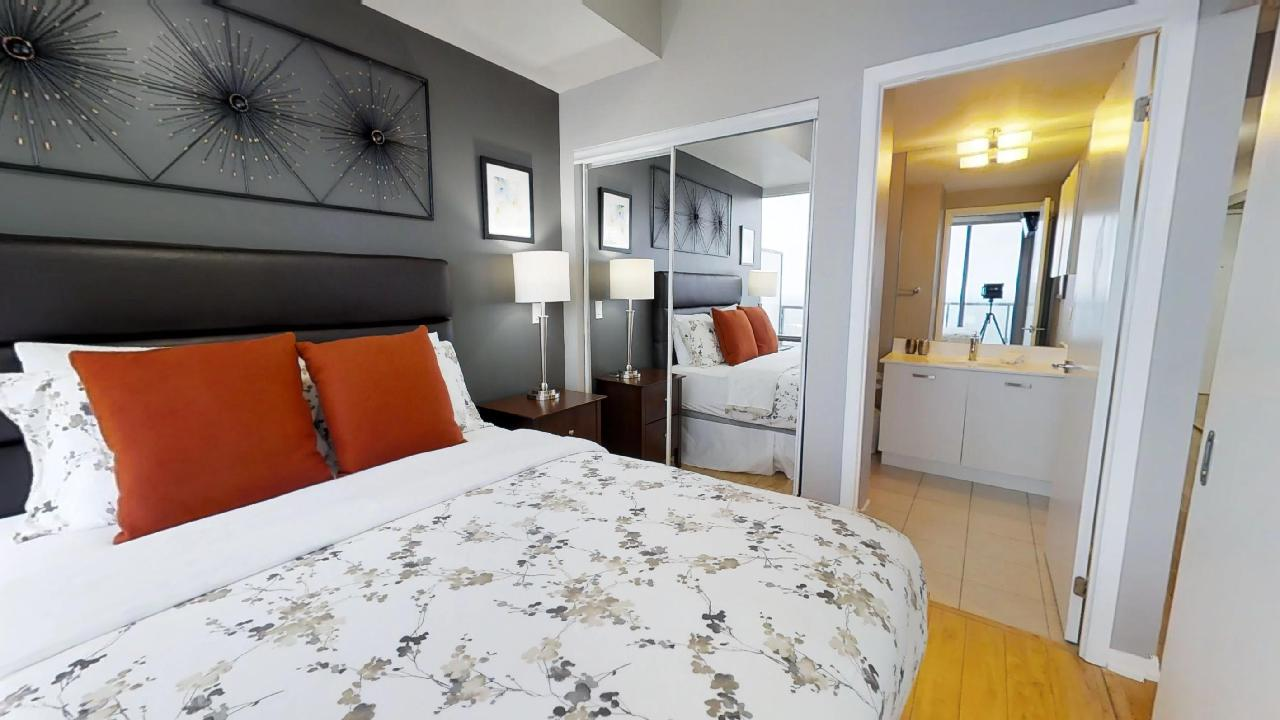 bedroom and bathroom in a fully furnished toronto condominium near bay and college